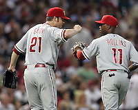 Phillies pitcher Adam Eaton celebrates with SS Jimmy Rollins after he turned a key double play against the Astros on Friday May 23rd at Minute Maid Park in Houston, Texas. Photo by Andrew Woolley / Four Seam Images.