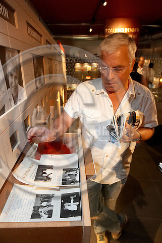 """BERLIN - GERMANY 15. JULY  2006 -- DDR Museum Berlin - Detlef Markmann, an earlier GDR citizen now German citizen in the museum - The GDR ceased to exist 17 years ago. Since then, there have been many exhibitions about the Berlin wall, the internal border between East and West Germany and about the government's strict surveillance (the agency known as Stasi), and now the DDR Museum Berlin shows the everyday life in the GDR in some of its aspects  -- PHOTO: CHRISTIAN T. JOERGENSEN / EUP & IMAGES..This image is delivered according to terms set out in """"Terms - Prices & Terms"""". (Please see www.eup-images.com for more details)"""