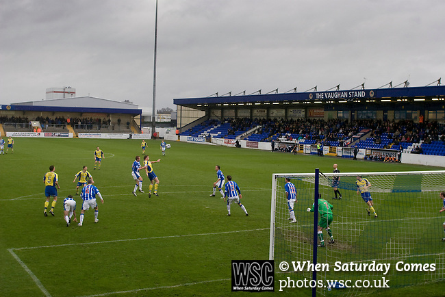 Chester City 1 Altrincham 3, 21/11/2009. Deva Stadium, Football Conference. The home team defend a corner during the first-half at the Deva Stadium, Chester, home of Chester City Football Club (in blue), during the club's Blue Square Premier fixture against Cheshire rivals Altrincham, as the visitors celebrate with their flags. The visitors won by three goals to one. Chester were in administration at the start of the season and were penalised 25 points before the season began. Photo by Colin McPherson.