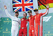 25th March 2018, Melbourne Grand Prix Circuit, Melbourne, Australia; Melbourne Formula One Grand Prix, race day; Lewis Hamilton of Great Britain, Sebastian Vettel and Kimi Raikkonen of Finland celebrate their podium places