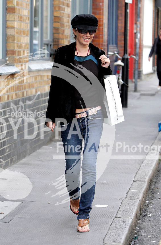 LONDON <br /> PICTURES BY: PERSIA/EAGLEPRESS<br /> PLEASE CREDIT ALL USES<br /> ----------------------------------<br /> SADIE FROST RETURNING FROM A SHOPPING TRIP WITH A FRIEND ONLY TO FIND A PARKING TICKET ON HER CAR<br /> ----------------------------------<br /> CONTACT:  JAVIER MATEO <br /> 16 NORTH POLE ROAD<br /> LONDON W10 6QL<br /> MOBILE: +44 778651 4443<br /> EMAIL: photos@eaglephoto.co.uk