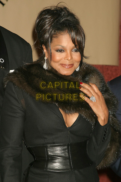 JANET JACKSON.One Hundred BlackMen 25th Annual Benefit Gala at The Hilton Towers In New York City. .November 11, 2004.half length, fur collar, wide black belt, cleavage, ring, earrings, jewellery.www.capitalpictures.com.sales@capitalpictures.com.© Capital Pictures