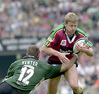 10/04/2002 - Powergen National Cup Final - Twickenham.London Irish vs Northampton..Exiles Brendan Venter, hangs onto Nick Beal..