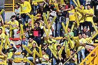 BOGOTA - COLOMBIA -05 -11-2016: Hinchas de Atletico Bucaramanga, animan a su equipo, durante partido entre La Equidad y Atletico Bucaramanga, por la fecha 19 de la Liga Aguila II-2016, jugado en el estadio Metropolitano de Techo de la ciudad de Bogota. / Fans of Atletico Bucaramanga, cheer for their team during a match La Equidad and Atletico Bucaramanga, for the  date 19 of the Liga Aguila II-2016 at the Metropolitano de Techo Stadium in Bogota city, Photo: VizzorImage  / Luis Ramirez / Staff.