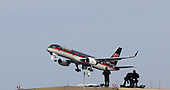 United States President-elect Donald Trump's plane, a Boeing 757-200 departs from LaGuardia Airport en route to Ohio for an event as police officers on a rooftop are seen in the foreground in New York, New York, USA, 08 December 2016.<br /> Credit: Justin Lane / Pool via CNP