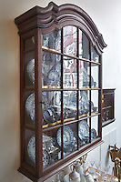 A Dutch 18th century wall cabinet displays a collection of Chinese porcelain from the K'ang Hsi period, around 1700
