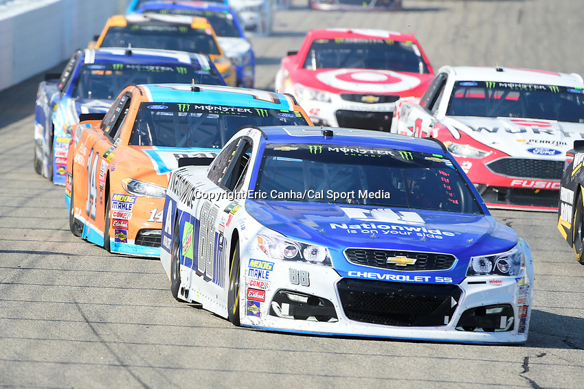 July 16, 2017 - Loudon, New Hampshire, U.S. - Dale Earnhardt Jr., Monster Energy NASCAR Cup Series driver of the Nationwide Chevrolet (88), heads into turn 1 at  the NASCAR Monster Energy Overton's 301 race held at the New Hampshire Motor Speedway in Loudon, New Hampshire. Eric Canha/CSM