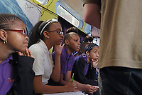 New York, NY, USA - May 23, 2017: The Biobus and crew visit the Girls Prep Middle School in the Bronx to offer students a science program in microscopic discovery. On board: Rob Frawley, Ph.D., Staff Scientist, Qiao Feng, Ph.D., Li Murphy, Lab Manager, Sascha Russel, Ph.D., Staff Scientist, and driver Raymond Wilkerson.