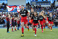Brad Barritt, mascot in hand, leads the Saracens team out onto the field. Aviva Premiership match, between Saracens and Bath Rugby on January 30, 2016 at Allianz Park in London, England. Photo by: Patrick Khachfe / Onside Images