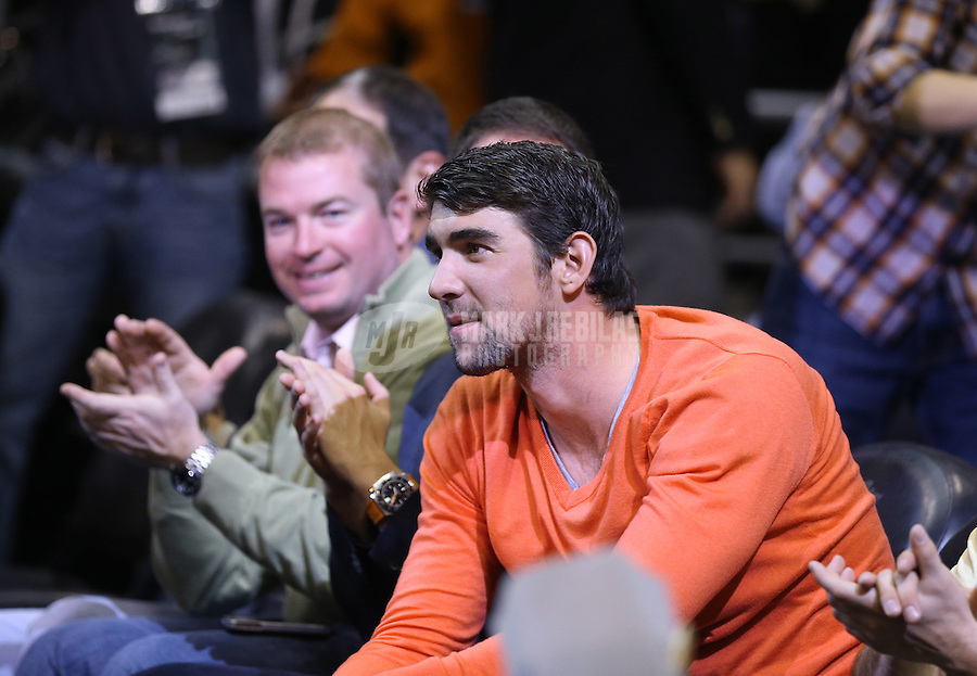 Jan. 30, 2013; Phoenix, AZ, USA: Olympic swimmer Michael Phelps sits court side of the game between the Phoenix Suns against the Los Angeles Lakers at the US Airways Center. Mandatory Credit: Mark J. Rebilas-