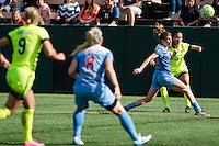 Seattle, WA - Sunday, May 22, 2016: Seattle Reign FC defender Carson Pickett (16) crosses the ball during a regular season National Women's Soccer League (NWSL) match at Memorial Stadium. Chicago Red Stars won 2-1.
