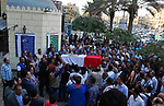 Egyptians carry the coffin of Police captain Ahmed Fayez during his funeral outside El Hosary Mosque in the capital Cairo's western suburb of Sixth of October, on October 21, 2017. Fayez died the previous night during an attack that left him and dozens of other policemen killed in an ambush by Islamist fighters. An official statement said a number of the attackers were killed, but did not give any figures for losses on either side. Medics and security sources gave a death toll of 35 among police. Photo by Stranger