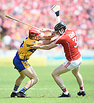 John Conlon of Clare in action against Damien Cahalane of Cork during their Munster senior hurling final at Thurles. Photograph by John Kelly.