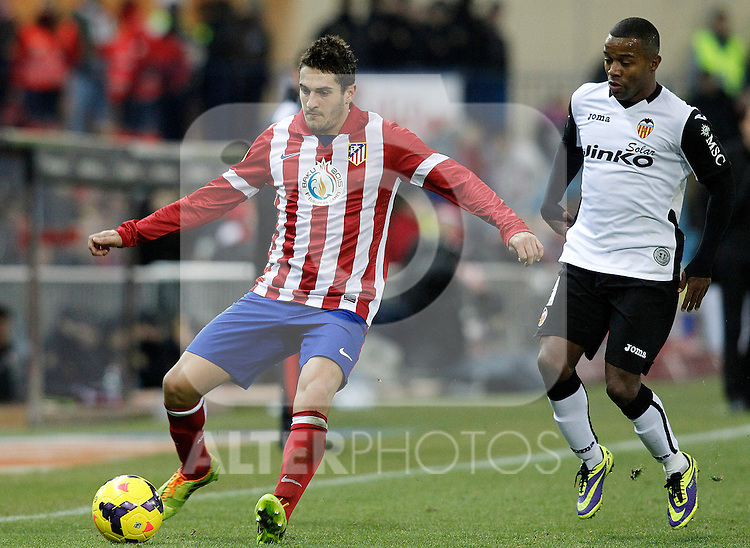 Atletico de Madrid's Koke (l) and Valencia's Dorlan Pabon during La Liga match.December 15,2013. (ALTERPHOTOS/Acero)