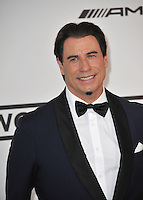 John Travolta  at the 21st annual amfAR Cinema Against AIDS Gala at the Hotel du Cap d'Antibes.<br /> May 22, 2014  Antibes, France<br /> Picture: Paul Smith / Featureflash