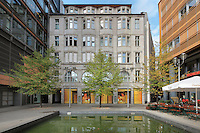 Buildings on Linkstrasse with shops and a cafe, around a pond, in the Potsdamer Platz quarter, Tiergarten, Berlin, Germany. Picture by Manuel Cohen
