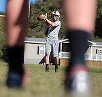 Kevin Whitaker throws a pass to his teammate during practice at Leslie County High School in Hyden, Ky. on Thursday, October 10, 2013. Photo by Adam Pennavaria