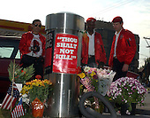 """Kensington, MD - October 22, 2002 -- Guardian Angels pay their respects at the spot where Lori Lewis-Rivera was killed by the """"Beltway Sniper"""" on 3 October, 2002.  The Angels were at the station to pump gas for motorists afraid to pump gas on their own.<br /> Credit: Ron Sachs / CNP<br /> (RESTRICTION: NO New York or New Jersey Newspapers or newspapers within a 75 mile radius of New York City)"""