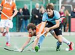 WASSENAAR - Hoofdklasse hockey heren, HGC-Bloemendaal (0-5)  Jorrit Croon (HGC) met links Manu Stockbroekx (Bldaal)     COPYRIGHT KOEN SUYK