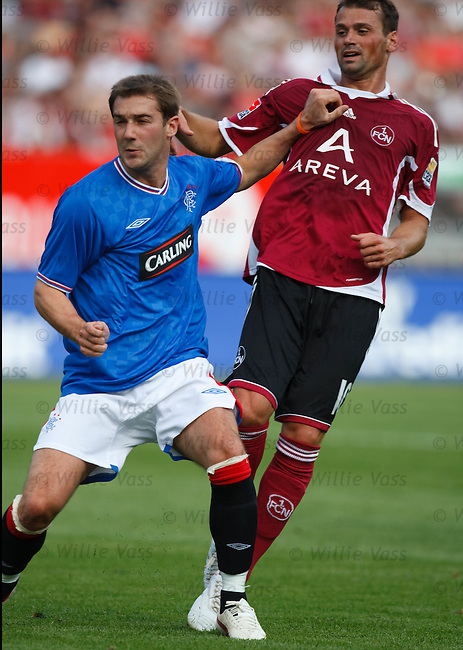 Kevin Thomson gets stuck into Albert Bunjaku