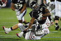 5 December 2009:  FIU running back Daunte Owens (8) is tackled by Florida Atlantic cornerback Marcus Bartels (27) in the first half as the Florida Atlantic University Owls defeated the FIU Golden Panthers, 28-21, in the annual Shula Bowl game at FIU Stadium in Miami, Florida.