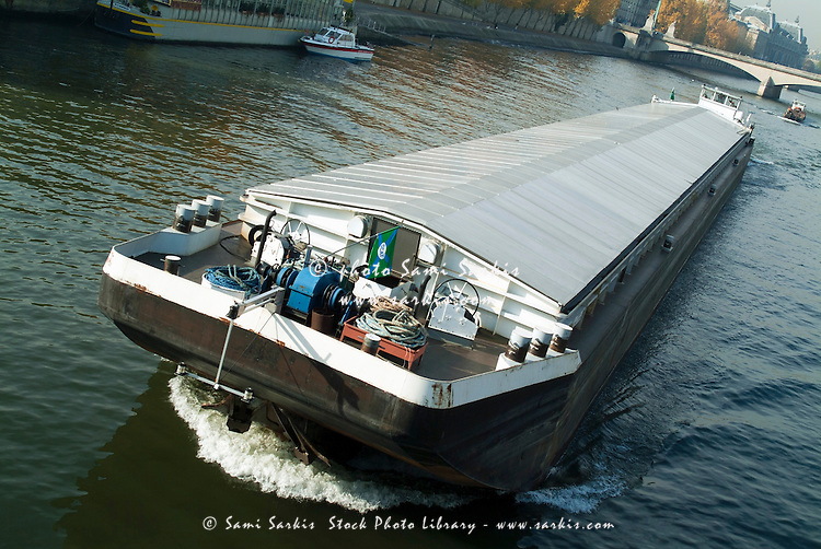 Barge travelling down the Seine, Paris, France.