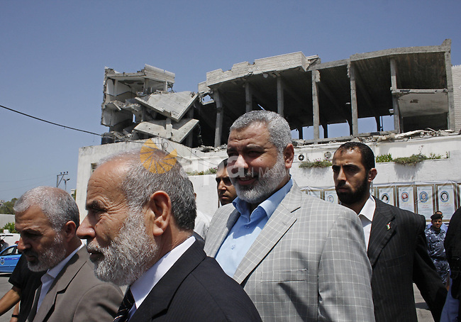 Senior Hamas leader Ismail Haniya visits the tent of the destroyed legislative council in Gaza City on July 1, 2009. Palestinian president Mahmud Abbas's Fatah party would defeat the rival Islamist faction Hamas if a legislative election were held now, according to an opinion poll published on June 29. Fatah would win 38.5 percent of the vote compared to 18.8 percent for Hamas, with the remainder going to smaller factions, according to the survey conducted by the Jerusalem Media and Communication Centre (JMCC). Photo by Ashraf Amra