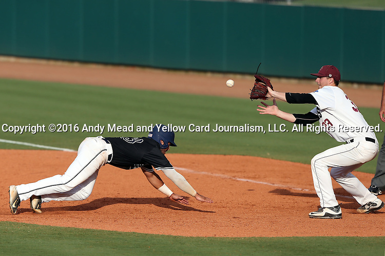 28 May 2016: Franklin Pierce's Tanner Bird (33) picks Nova Southeastern's Kevin Suarez (13) off of first base. The Nova Southeastern University Sharks played the Franklin Pierce University Ravens in Game 3 of the 2016 NCAA Division II College World Series  at Coleman Field at the USA Baseball National Training Complex in Cary, North Carolina. Nova Southeastern won the game 4-3 in twelve innings.