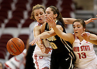 Ohio State Buckeyes guard Amy Scullion (25) and Ohio State Buckeyes guard Cait Craft (13) try to stop Purdue Boilermakers guard Hayden Hamby (10) from passing in the second half of a women's basketball game between the Ohio State Buckeyes and the Purdue Boilermakers at Value City Arena on January 2, 2014. ( Dispatch photo by Fred Squillante)
