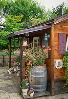 Garden tool shed decorated with recycled flea market style