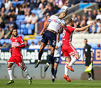 Bolton Wanderers' Darren Pratley wins an aerial battle with Middlesbrough's Adam Clayton<br /> <br /> Photographer Andrew Kearns/CameraSport<br /> <br /> The EFL Sky Bet Championship - Bolton Wanderers v Middlesbrough - Saturday 9th September 2017 - Macron Stadium - Bolton<br /> <br /> World Copyright &copy; 2017 CameraSport. All rights reserved. 43 Linden Ave. Countesthorpe. Leicester. England. LE8 5PG - Tel: +44 (0) 116 277 4147 - admin@camerasport.com - www.camerasport.com