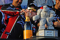 Sept. 20, 2008; Dover, DE, USA; Nascar Nationwide Series driver Kyle Busch attempts to use a set of rental car keys to open a bottle of champagne after the cork broke as he attempted to open it in victory lane after winning the Camping World RV 200 at Dover International Speedway. Mandatory Credit: Mark J. Rebilas-