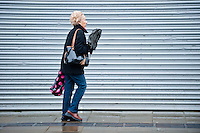 Wednesday 12 February 2014<br /> Pictured: A woman struggles to walk against the wind in Swansea City centre<br /> Re: People struggle with the high winds in the center of Swansea. The met office has today issued more warnings of extreme weather over the next few days.