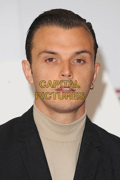 Theo Hutchcraft from Hurts.The UK Creative Industries Reception supported by The Founders Forum, at the Royal Academy of Arts, London, as part of HM Government's GREAT campaign alongside the very best of the UK Creative Industries from the fields of music, film, art and entertainment..30th July 2012 .headshot portrait black beige high collar top.CAP/BEL.©Tom Belcher/Capital Pictures.