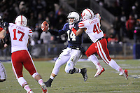 23 November 2013:  Nebraska LB David Santos (41) tackles Penn State QB Christian Hackenberg (14). The Nebraska Cornhuskers defeated the Penn State Nittany Lions 23-20 in overtime at Beaver Stadium in State College, PA.