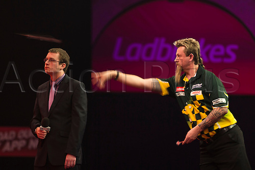 17.12.2013 London, England.  Simon Whitlock in action against Ross Smith during the Ladbrokes World Darts Championships from Alexandra Palace