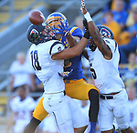 BROOKINGS, SD - SEPTEMBER 26:  Jake Weineke #19 from South Dakota State can not come up with the ball on a pass interference by Andy Smigiera #18 from Robert Morris as teammate Marcelis Branch #5 helps in the first quarter Saturday evening at Coughlin Alumni Stadium.  (Photo by Dave Eggen/Inertia)
