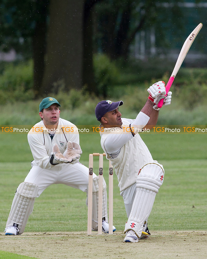 Milan Patel, Wanstead CC hits through mid wicket - Chelmsford CC vs Wanstead CC - Essex Cricket League at Chelmer Park - 09/06/12 - MANDATORY CREDIT: Ray Lawrence/TGSPHOTO - Self billing applies where appropriate - 0845 094 6026 - contact@tgsphoto.co.uk - NO UNPAID USE.