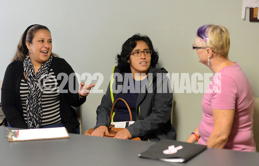 From left, students Raquel Rivera, Martha Soto and volunteer Carol Myers chat before the start of a Welcoming The Stranger english as a second language class Thursday October 8, 2015 in Warminster, Pennsylvania. (Photo by William Thomas Cain)