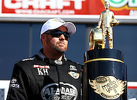 Nov 10, 2013; Pomona, CA, USA; NHRA top fuel dragster driver Shawn Langdon takes the stage to his championship trophy during the Auto Club Finals at Auto Club Raceway at Pomona. Mandatory Credit: Mark J. Rebilas-
