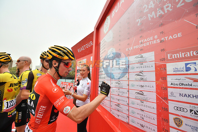 Race leader Primoz Roglic (SLO) and Team Jumbo-Visma sign on before the start of Stage 6 of the 2019 UAE Tour, running 175km form Ajman to Jebel Jais, Dubai, United Arab Emirates. 1st March 2019.<br /> Picture: LaPresse/Massimo Paolone | Cyclefile<br /> <br /> <br /> All photos usage must carry mandatory copyright credit (© Cyclefile | LaPresse/Massimo Paolone)