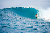 INDONESIA, Mentawai Islands, Kandui Resort, man surfing a wave called Bankvaults