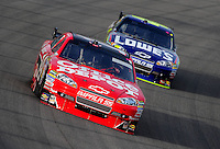 Nov. 22, 2009; Homestead, FL, USA; NASCAR Sprint Cup Series driver Tony Stewart (14) leads Jimmie Johnson (48) during the Ford 400 at Homestead Miami Speedway. Mandatory Credit: Mark J. Rebilas-