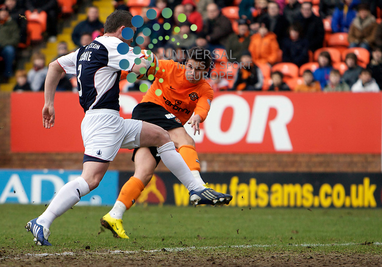 Scottish Clydesdale Bank Premier League, Championship Season 2009/10.Dundee United Football Club  V Falkirk Football Club...    Dundee United's David Goodwillie has an effort on goal, in today's thrilling and must win game for both sides, With United need ing the points to gain 3rd Spot in the table and Falkirk needing the points for Premier League survival. In the Clydesdale Bank Scottish Premier League encounter between Dundee United and Falkirk..At Tannadice Park Stadium, Dundee...Picture, Mark Davison/Universal News and Sport .