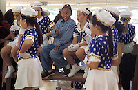 Nina, the consumate performer, entertains her friends at a musical theater dress rehersal. Nina is eager to reherse even though she hasn't received her costume from the instructor yet. Nina starred in a music video with Aaron Nevile and has made two TV pilots. Nina's unique wit has charmed Neville into becoming a close personal friend of the Smith family. (photo by Pico van Houtryve)