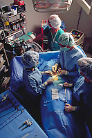 Overhead shot of  doctor, two nurses and anathesiologist in operating room