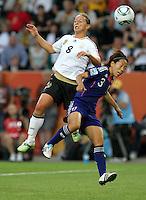 Wolfsburg , 100711 , FIFA / Frauen Weltmeisterschaft 2011 / Womens Worldcup 2011 , Viertelfinale ,  Deutschland (GER) - Japan (JPN) .Inka Grings (GER) gegen Azusa Iwashimizu (JPN) .Foto:Karina Hessland .