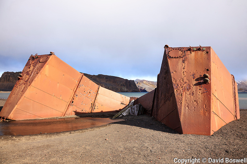 Remnants of the bygone whaling era such as thie rusted floating dock abound at Whalers Bay, the site of an abandoned Norwegian whaling base on Decpetion Island, located in the South Shetland Islands near the Antarctic Peninsula.