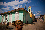 Cubans walk through Plaza Mayor, in Trinidad, Cuba, on Thursday, April 24, 2008. This 500-year old city is also an UNESCO World Heritage Site.
