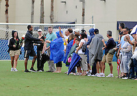 Florida International University women's soccer Head Coach Thomas Chestnutt hands a rose to parents at half-time of the game against the University of Denver on October 16, 2011 at Miami, Florida. FIU won the game 1-0. .
